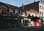 Image of damaged stores Washington DC, 1968, second 13 stock footage video 65675078124