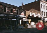 Image of damaged stores Washington DC, 1968, second 15 stock footage video 65675078124