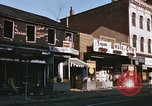 Image of damaged stores Washington DC, 1968, second 16 stock footage video 65675078124