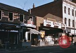Image of damaged stores Washington DC, 1968, second 17 stock footage video 65675078124