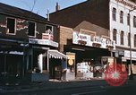 Image of damaged stores Washington DC, 1968, second 18 stock footage video 65675078124