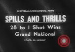 Image of Grand National Liverpool England, 1962, second 3 stock footage video 65675078220