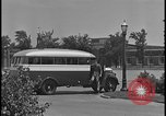 Image of Young men and women punch  time clock at Ford facility Dearborn Michigan  USA, 1938, second 8 stock footage video 65675078259