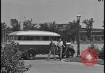 Image of Young men and women punch  time clock at Ford facility Dearborn Michigan  USA, 1938, second 10 stock footage video 65675078259