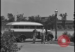 Image of Young men and women punch  time clock at Ford facility Dearborn Michigan  USA, 1938, second 11 stock footage video 65675078259