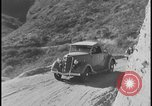 Image of Ford cars being tested in rugged conditions United States USA, 1932, second 5 stock footage video 65675078263