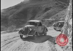 Image of Ford cars being tested in rugged conditions United States USA, 1932, second 7 stock footage video 65675078263